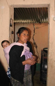 Crisanta Hernández Peréz stands in her house that has allegedly been cracked by Goldcorp's underground blasting, Ágel, San Miguel Ixtahuacán, San Marcos, Guatemala